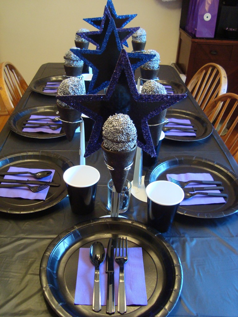 the full table with glittery stars and edible microphones